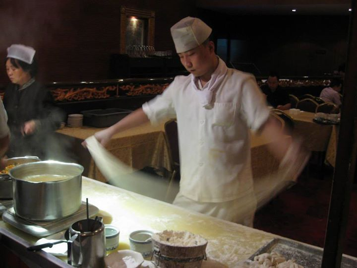 The process of preparing hand pulled noodles is so quick that it happens in a blur!