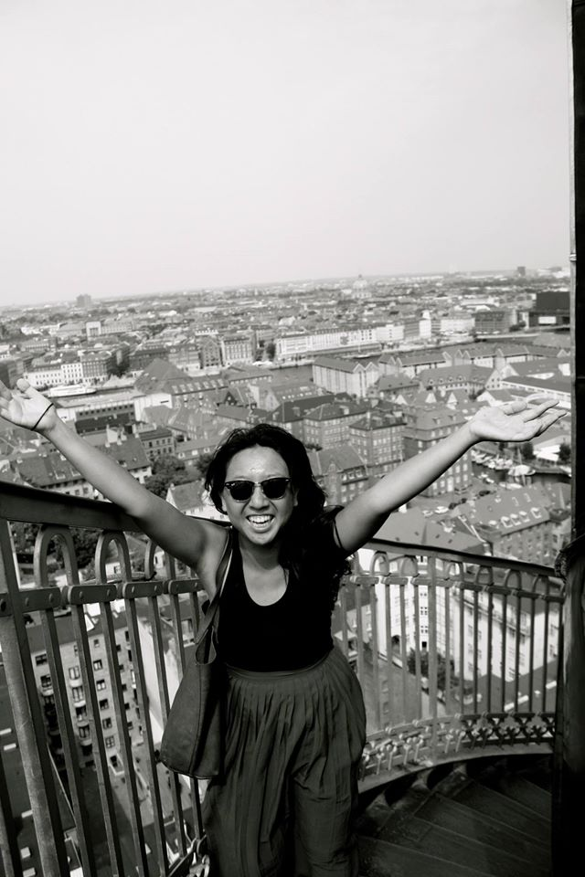 Virginia Yu smiles for the camera overlooking a typical Denmark scene.